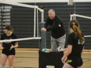 Coach Jeff Nesbitt demonstrates proper posture to Woodland volleyball players during practice at Woodland High School, Wednesday November 9, 2016.