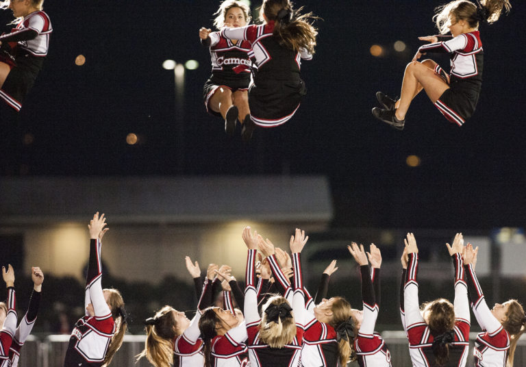 Camas cheerleaders perform during the first playoff game at Doc Harris Stadium in Camas, Friday November 4, 2016. (Ariane Kunze/The Columbian)