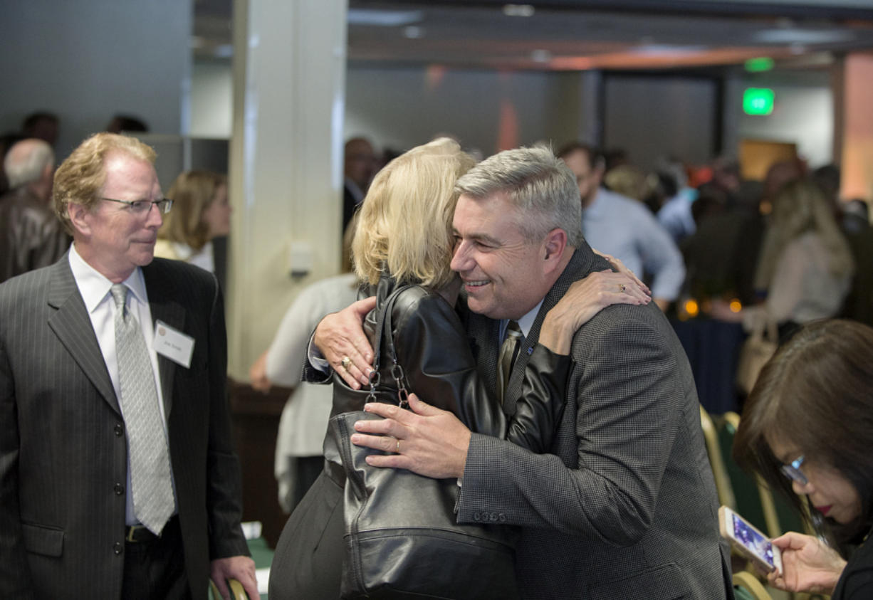 Joe Smith, from left, and his wife, Barbara Kerr, a former Clark College communications officer, congratulate First Citizen Bob Knight at WareHouse '23 in Vancouver on Wednesday afternoon.