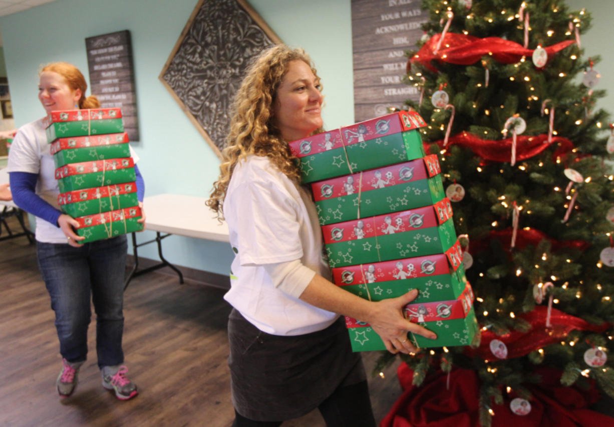 Operation Christmas.670 Shoeboxes Family Floods Donation Program With Gifts