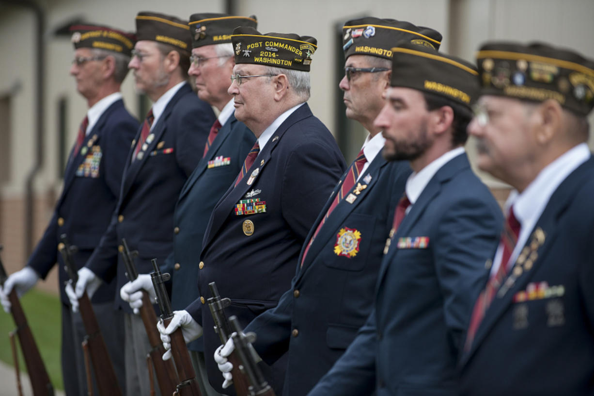 Members of the Veterans of Foreign Wars Post 7824 honor guard prepare to give a rifle salute during the Veterans Day observance Friday at the Armed Forces Reserve Center.