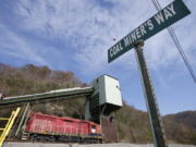 A road sign is posted at the entranced the closed Spruce Creek coal mine in Matewan, W.Va., on Friday. The hard-eyed view along the Tug Fork River in coal country is that Donald Trump has to prove he'll help Appalachian mining like he promised.