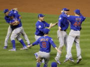 The Chicago Cubs celebrate after Game 7 of the Major League Baseball World Series against the Cleveland Indians Thursday, Nov. 3, 2016, in Cleveland. The Cubs won 8-7 in 10 innings to win the series 4-3. (AP Photo/Gene J.