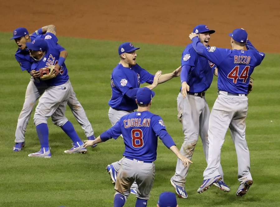 0a9796b930b The Chicago Cubs celebrate after Game 7 of the Major League Baseball World  Series against the