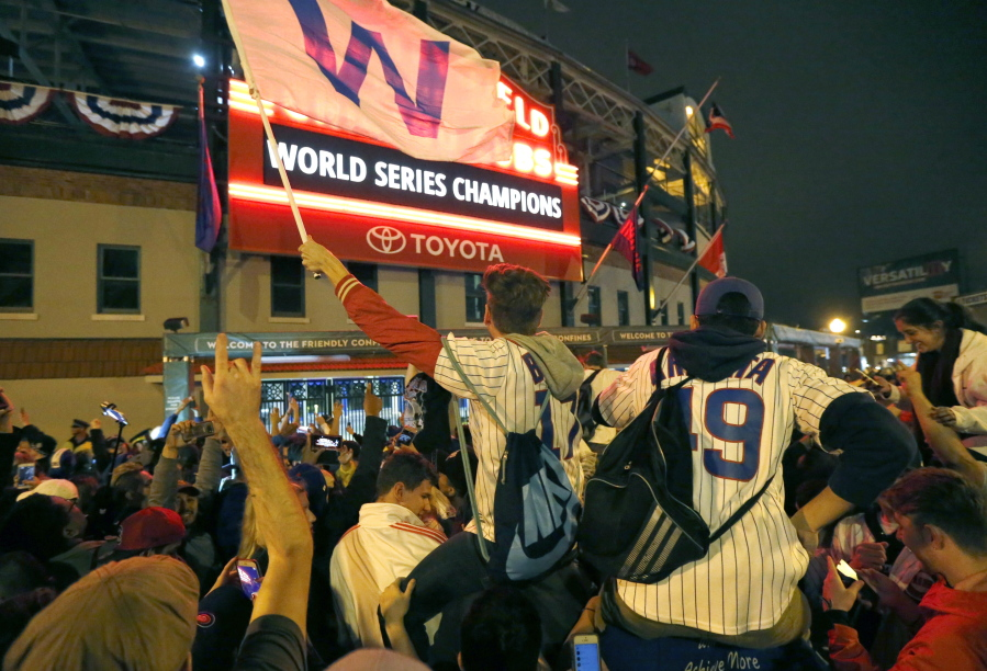 9fcd540b0e3 Chicago Cubs fans celebrate in front of Wrigley Field in Chicago on  Wednesday after the Cubs
