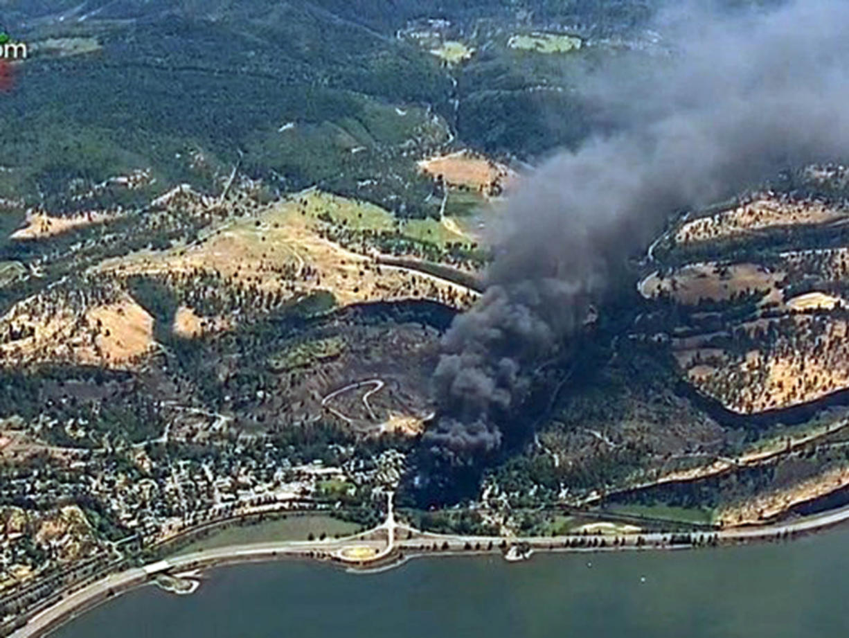 Smoke billows from a Union Pacific train that derailed June 3 near Mosier, Ore., in the Columbia River Gorge. (KGW-TV/Associated Press files)