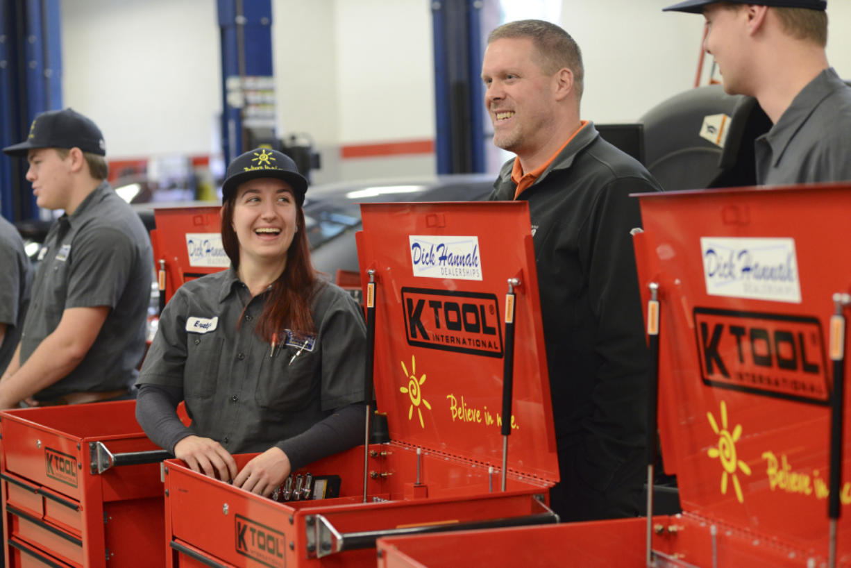 Evelyn Nagornyy, a first-year student in Clark College's automotive technology program, left, talks to Tom Gilstrap, center, a service manager at Dick Hannah Subaru, during a small ceremony at Clark College where automotive technology students received toolboxes from the Dick Hannah Dealerships in Vancouver. (Ariane Kunze/The Columbian)