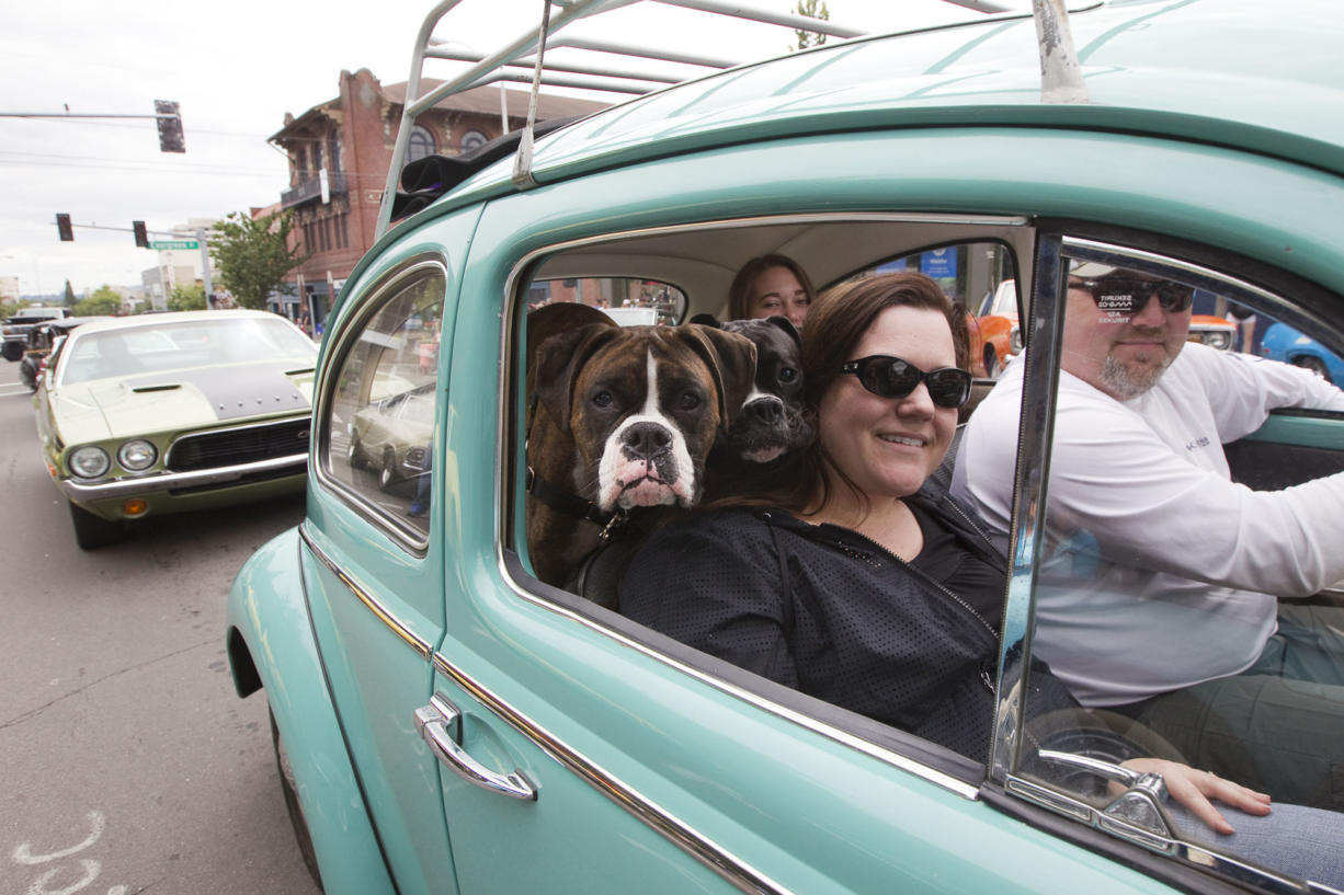 "Susan Schrantz takes part in ""Cruisin' the Gut"" with her family in a VW Bug on Main Street in downtown Vancouver in 2016."