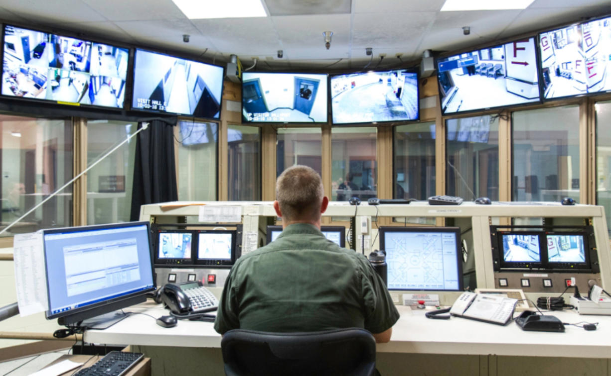 A corrections officer monitors security video feeds at the Clark County Jail. Although the county has worked to reduce the number of inmate deaths by suicide at the jail, by raw numbers, Clark County's jail has seen more inmate suicides over the past several years than any in the state.