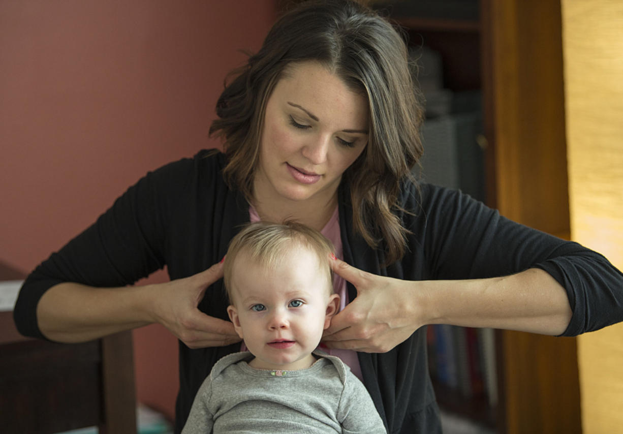 Chiropractor Cecelia Mikles checks 13-month-old Briar Freitas' cranium bones during an appointment Nov. 28. Mikles discovered Briar's cranium bones were shifting and uneven.