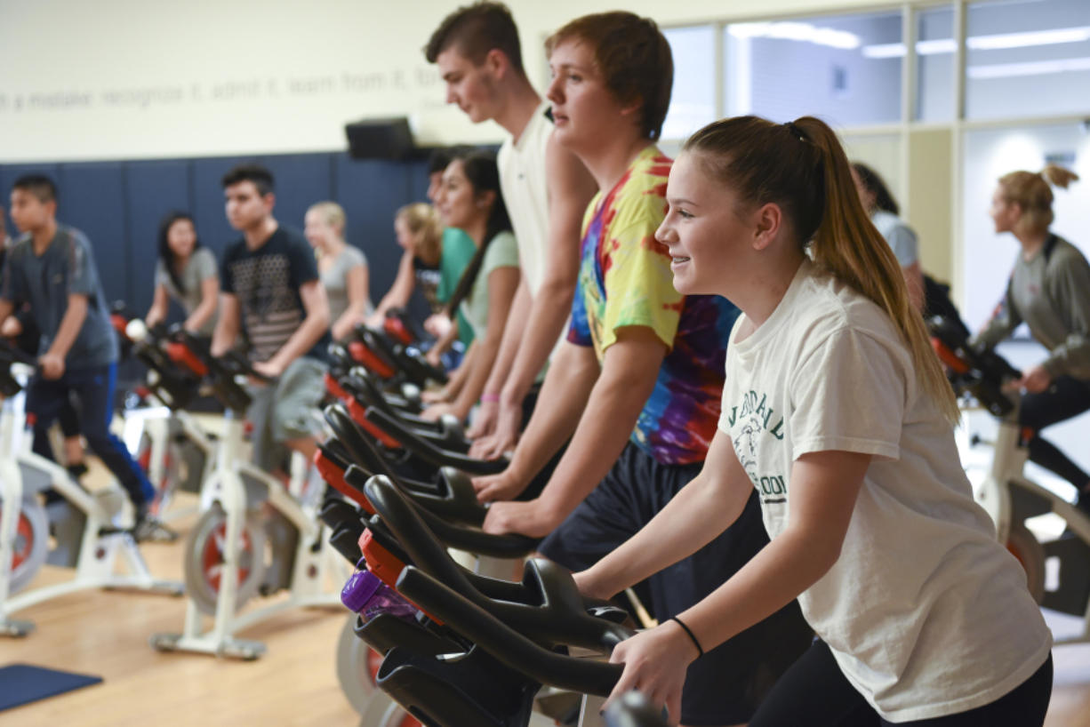 Woodland High School sophomore Ashley Yoder participates in one of three spin classes offered at the school. School officials have wanted to bring the physical education class to Woodland for years and were able to when the new high school opened in 2015. (Ariane Kunze/The Columbian)