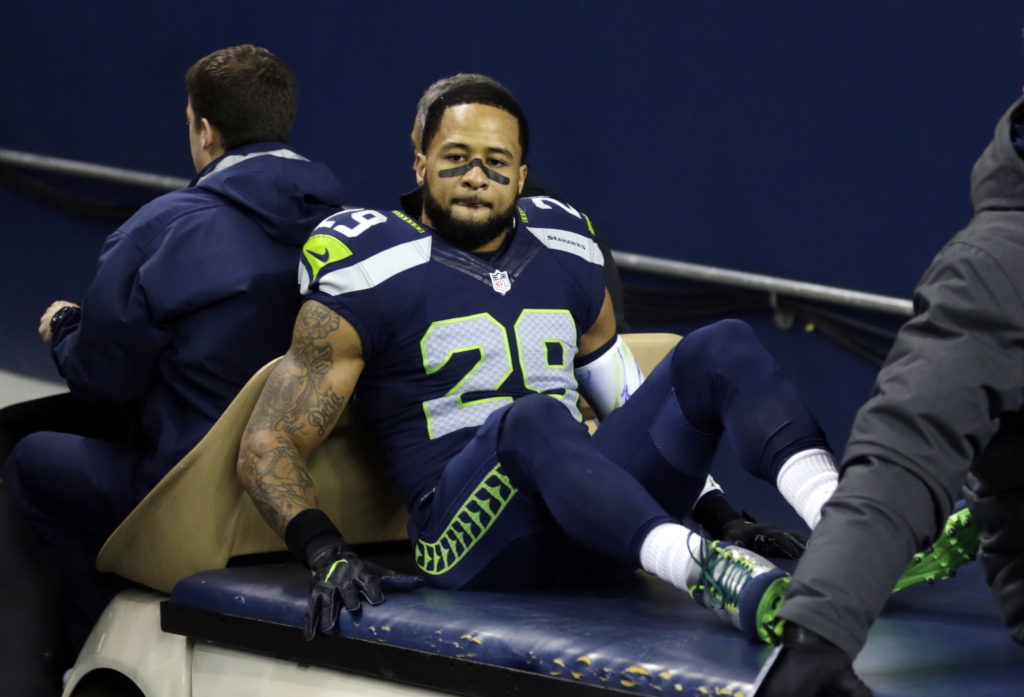 e4203ed3111 Seattle Seahawks  Earl Thomas leaves the field on a cart after being  injured against the