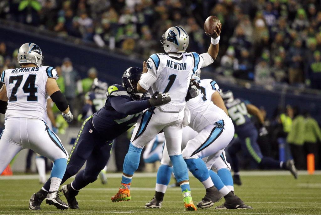 861a1a7424a Seattle Seahawks  Ahtyba Rubin pressures Carolina Panthers quarterback Cam  Newton as Newton get