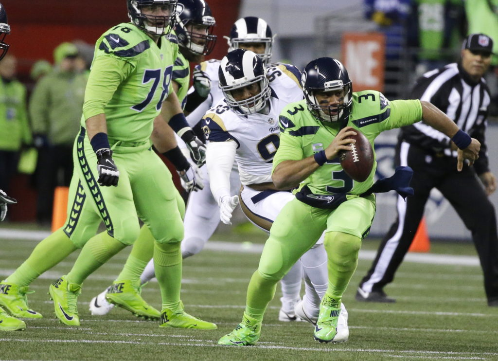 ef82f78e218 Seattle Seahawks quarterback Russell Wilson (3) scrambles away from Los  Angeles Rams defensive end
