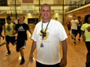 Hudson's Bay High School football coach Mark Oliverio at a gym workout for athletes at the school in Vancouver, Wa., Wednesday July 22, 2015.