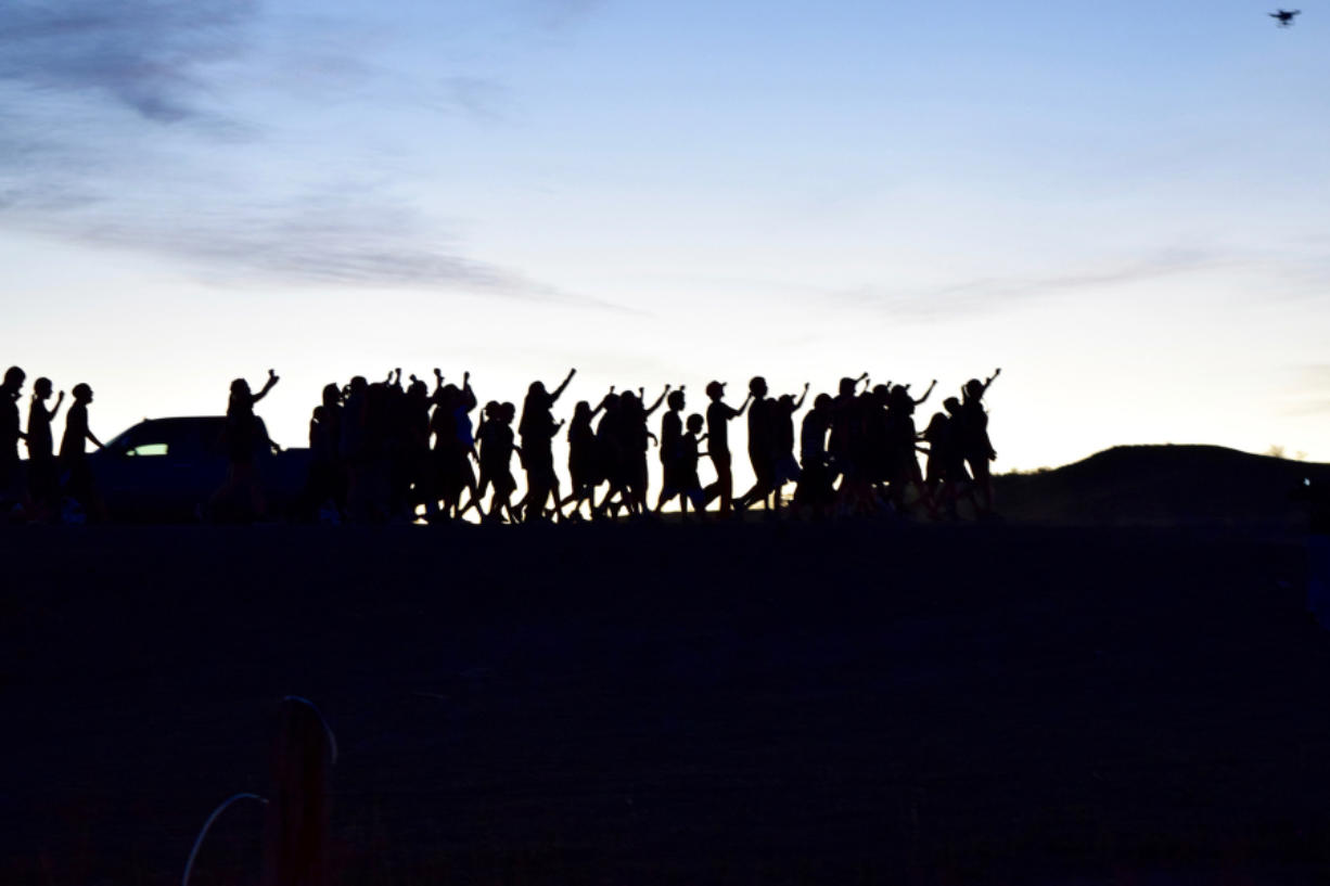 """Youth march and chant """"water is life"""" from the Cannonball to the Oceti Sakowin camp in North Dakota in October. Jacqueline Keeler, a Portland journalist who traveled to North Dakota to attend Dakota Access Pipeline protests, will be teaching a class on the protests at Clark College beginning next week."""