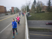 Runners make their way along the annual Race for Warmth route Sunday morning in Vancouver.