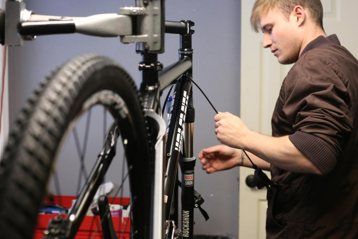 Wes Foster works on one of the many bicycles built by Volcanic Bikes. The North Bonneville-based company supplies heavy-duty bicycles to police departments such as those in Seattle, Washington, D.C., and Los Angeles.