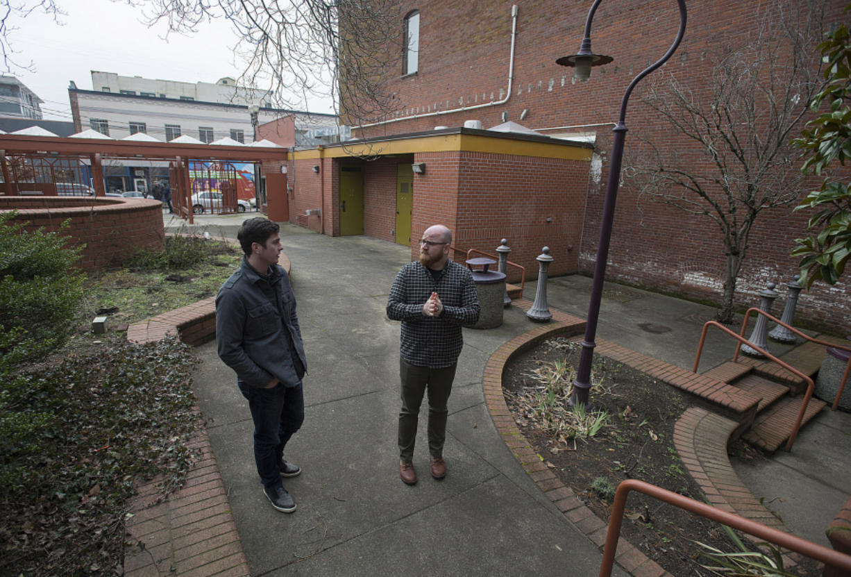 Kylan Johnson, left, and Alex Mickle of Columbia Food Park talk about their vision for the former site of The Urb Garden in downtown Vancouver. The pair aim to place kitchen-equipped shipping containers in the courtyard of the park to serve food.