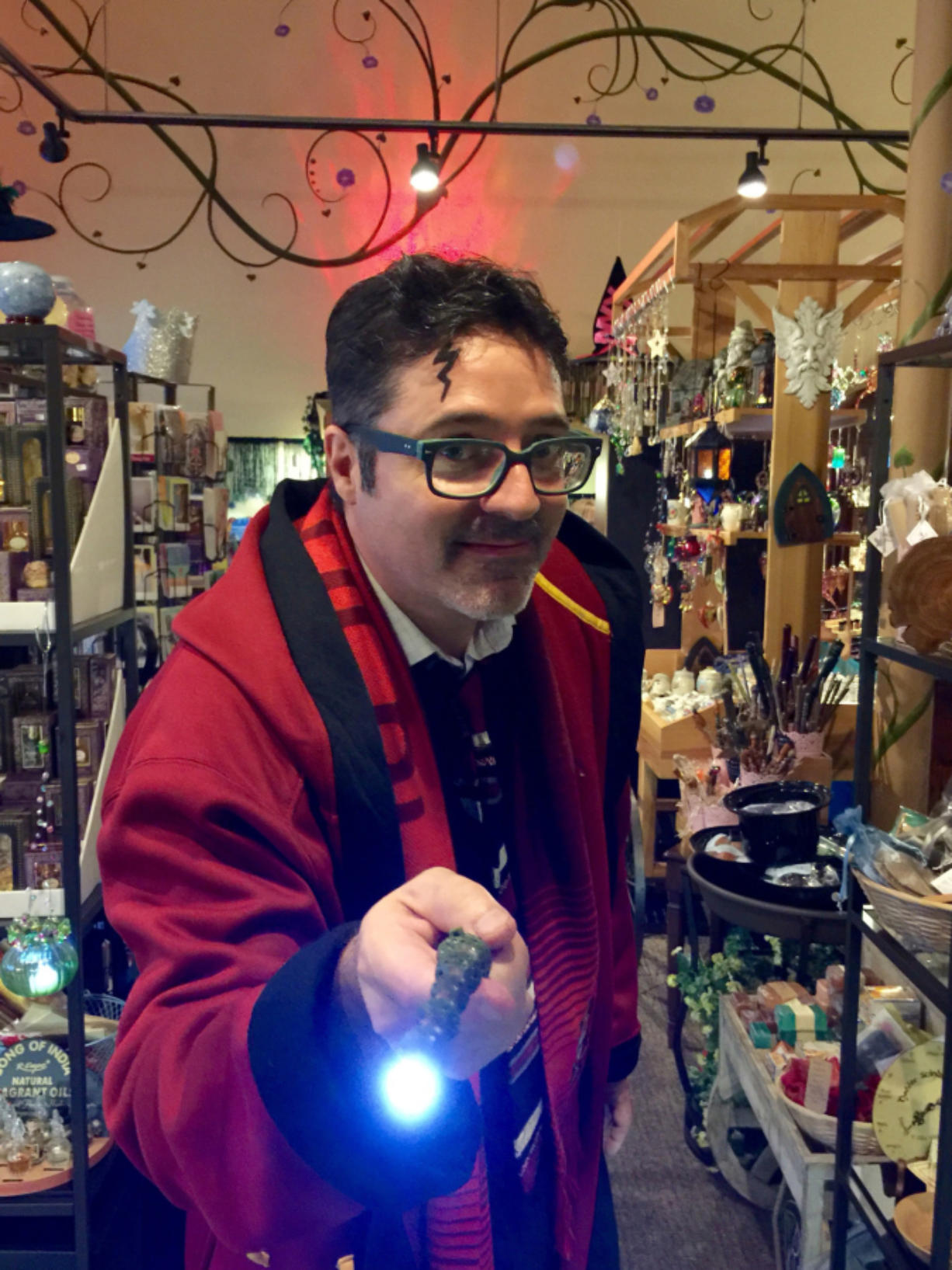 John LaBerge of Love Potion Magickal Perfumerie is dressed as the character Harry Potter.