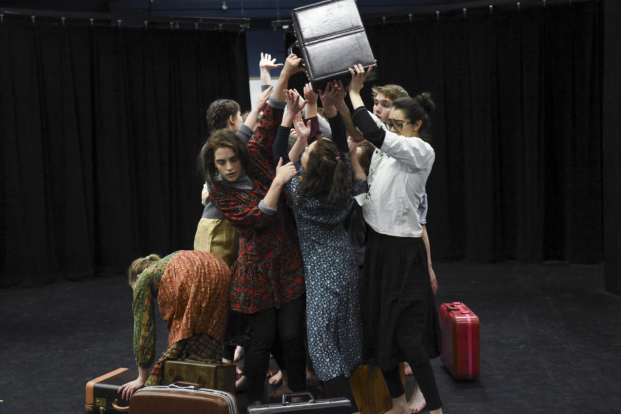 """Students in the advanced theater class at Vancouver School of Arts and Academics rehearse an original production, """"Neither Nor Both And: What's Left Behind,"""" in the black box theater. Theater teacher Judy Goff and VSAA alumnus Spenser Theberge collaborated on the original play."""