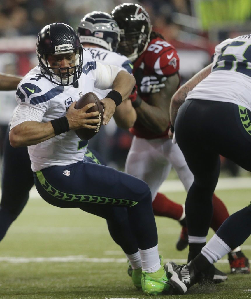 1e9fc9485 Seattle Seahawks quarterback Russell Wilson (3) trips at the line of  scrimmage against the