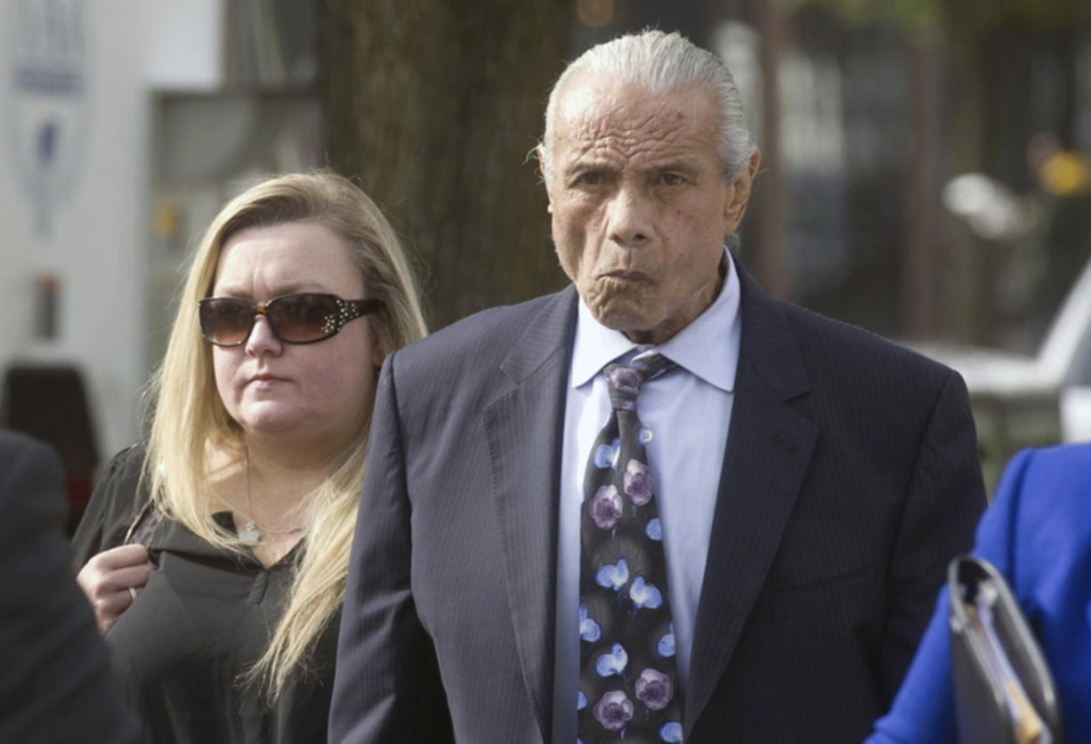 """Former professional wrestler Jimmy """"Superfly"""" Snuka, right, arrives for his formal arraignment in 2015 at the Lehigh County Courthouse in Allentown, Pa. In a decision filed Tuesday, Jan. 3, 2017, a Pennsylvania judge dismissed the murder case against Snuka in the 1983 death of his girlfriend Nancy Argentino, saying Snuka is not competent to stand trial on counts including third-degree murder. Snuka's attorney told a judge in December 2016 that his client is in hospice care in Florida and has six months to live."""
