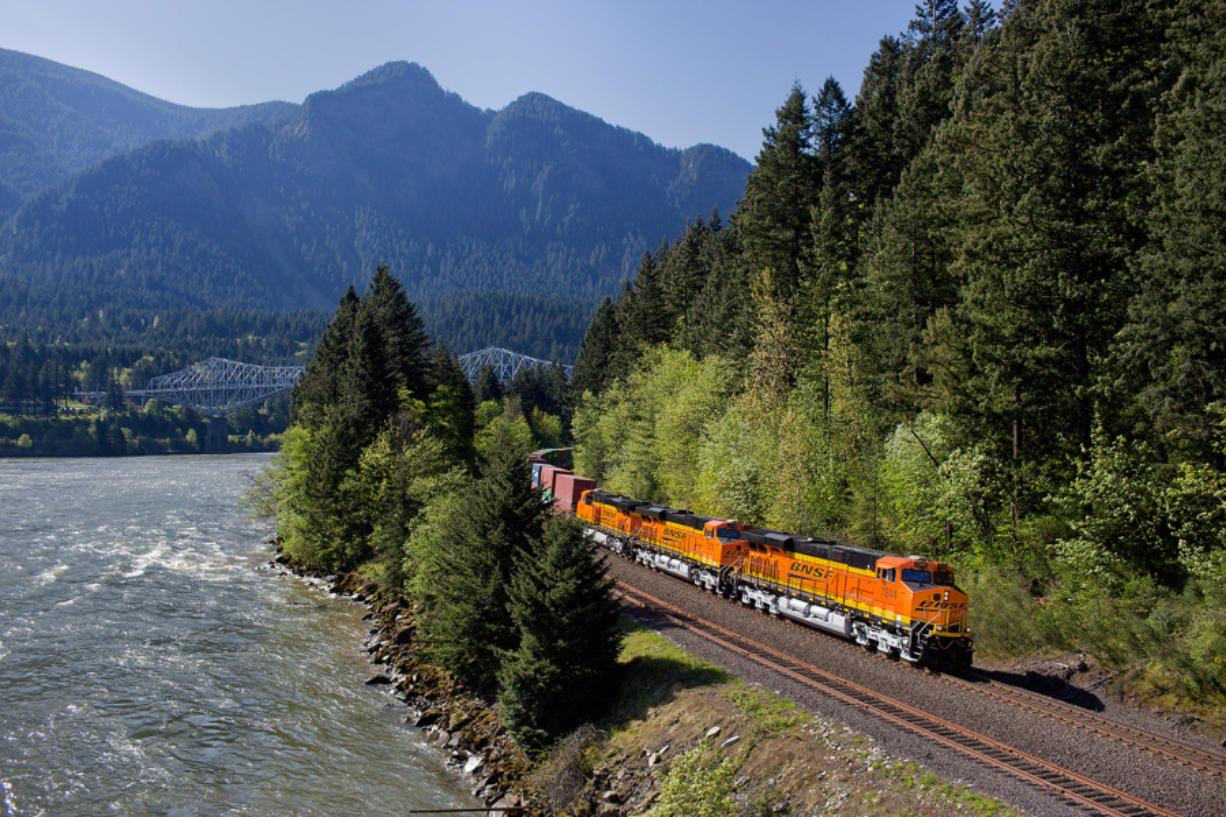 A BNSF Railway freight train rolls through the Columbia River Gorge.