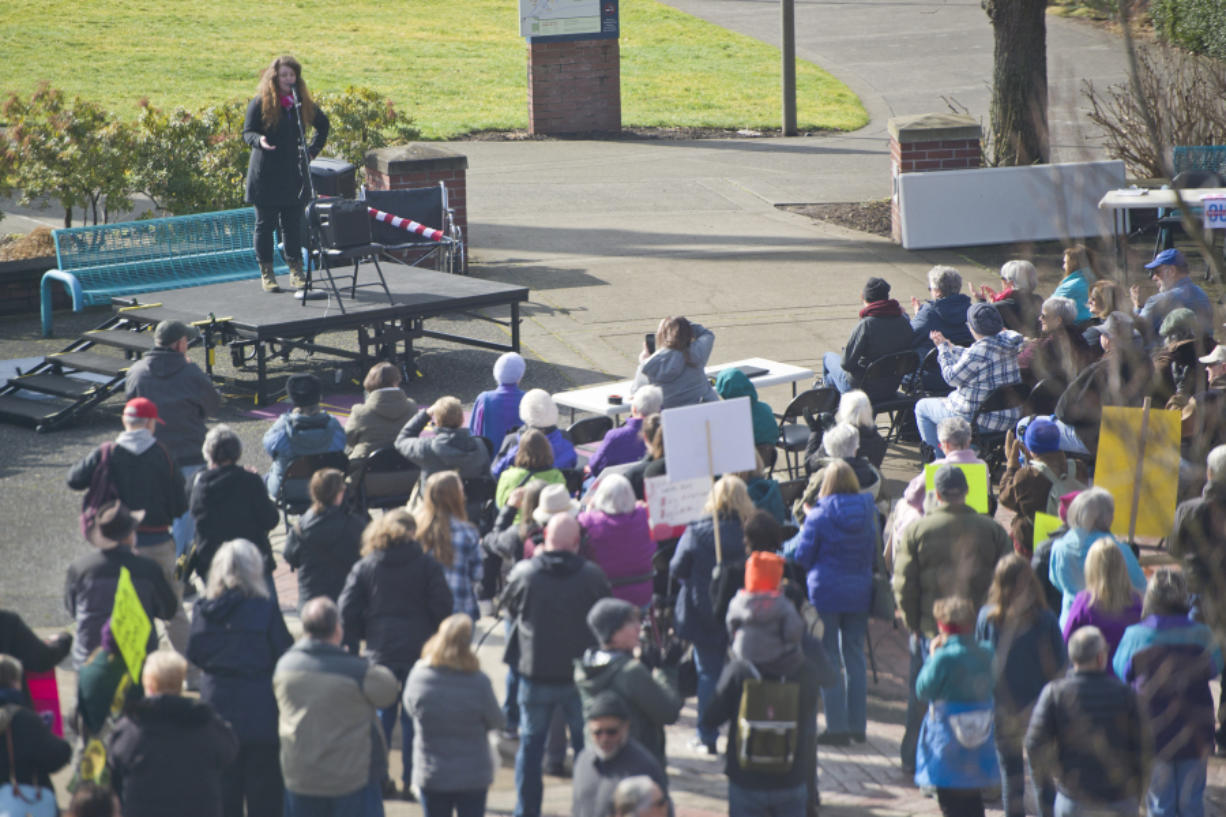 Audrey Miller of Planned Parenthood talks to people gathered for a Saturday rally to save the Affordable Care Act from repeal at Clark College in Vancouver.