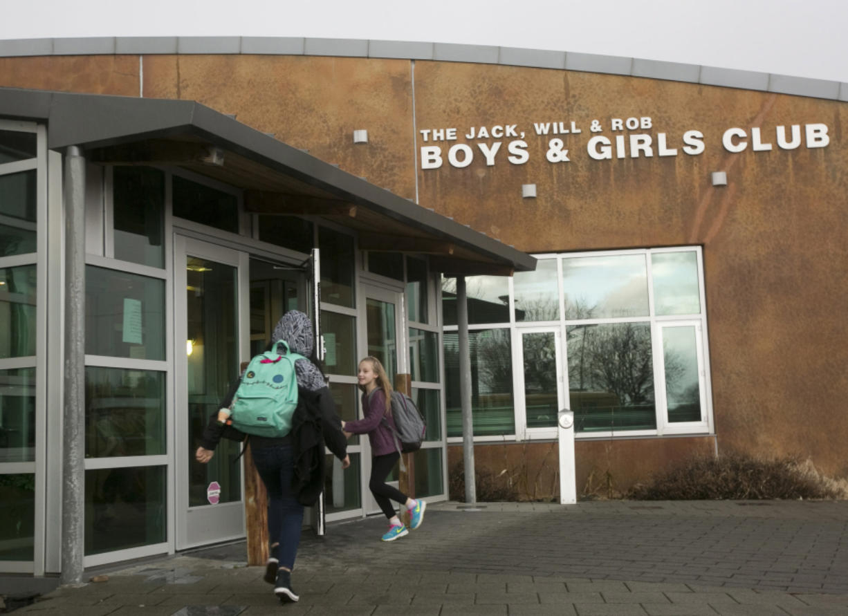 Students head Feb. 10 into the Jack, Will and Rob Club in Camas, where operations will transfer from the Boys & Girls Club of Portland to the Camas School District, which owns the center, starting in June. The Boys & Girls Club has operated there for the last 14 years.