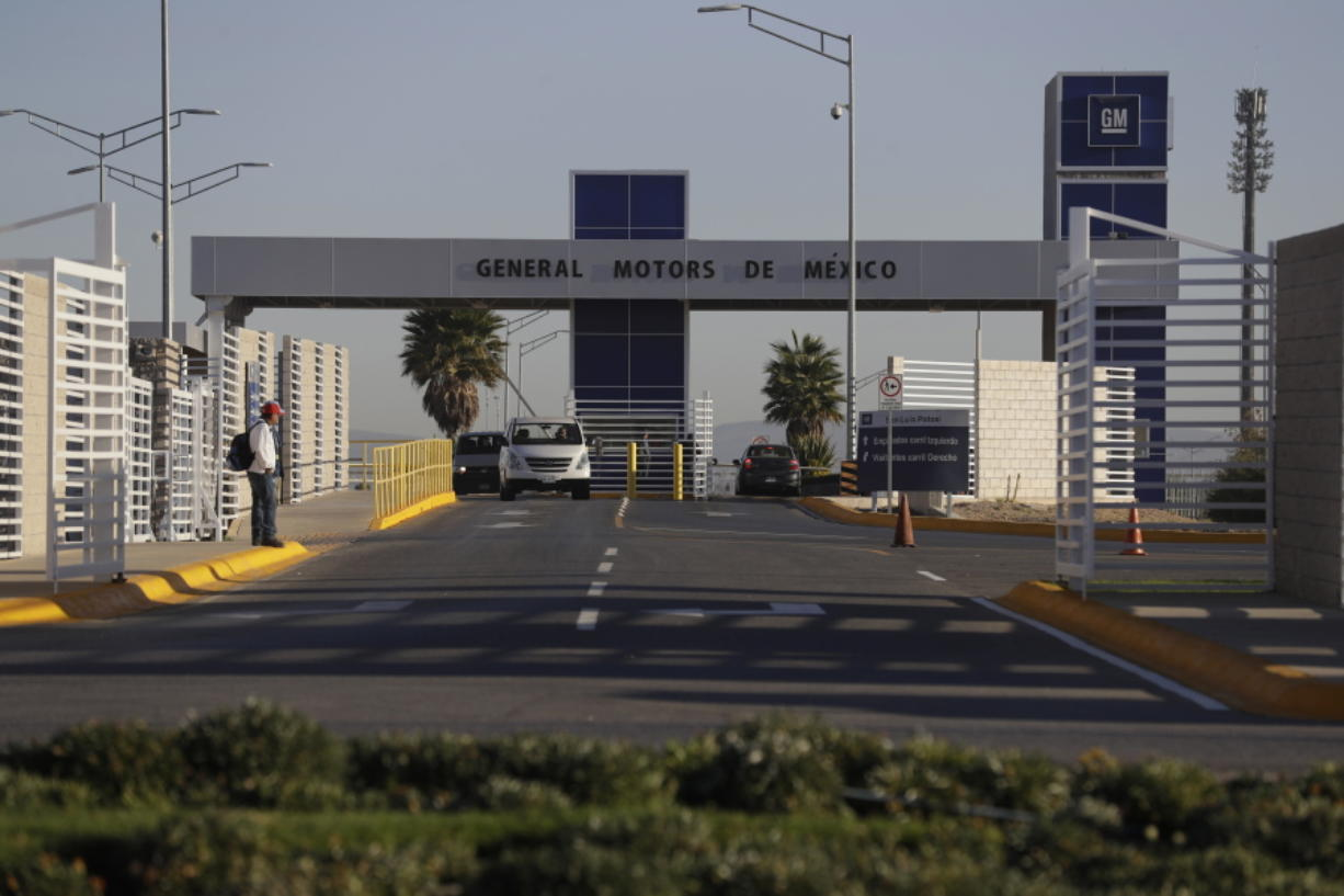 Cars exit the General Motors assembly plant in Villa de Reyes, outside San Luis Potosi, Mexico, where the Aveo and Trax vehicles have been produced since 2008.