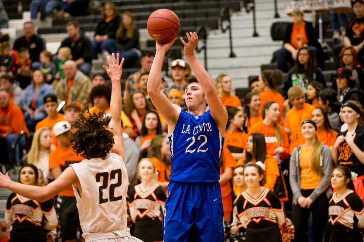 La Center's Matt Baher shoots over Zillah's Nate Whitaker during the first half of their Class 1A regional match-up at Davis High School in Yakima, Wash. on Saturday, Feb. 25, 2017.