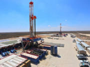 """A Patterson-UTI drilling rigs that uses hydraulic feet to """"walk"""" from one drill site to another. This one operates in West Texas."""