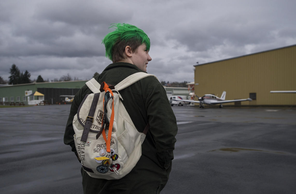Rachel Friesen of Vancouver strolls through Pearson Field while on her way to check out a plane owned by her grandfather, Ernst Friesen. Rachel is one of the youngest flight students at the school, and one of few females.
