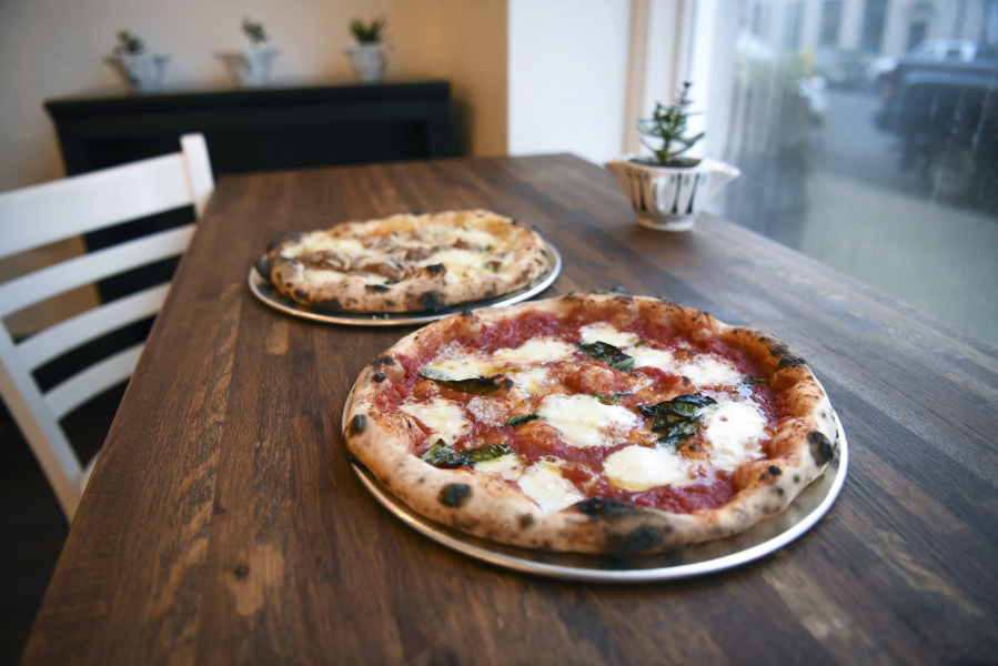 The Margherita Pizza Front And Bolognese Are Seen At Nonavo In Downtown