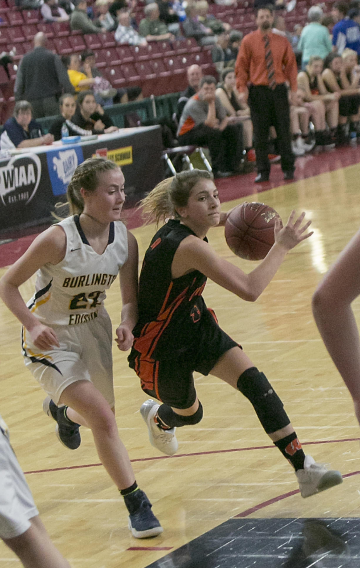 Washougal guard Mason Oberg (4), drives to the hoop before being blocked during the second round of the WIAA 2A girls state tournament on Thursday, Mar. 2, 2017, at the Yakima Valley SunDome. The Burlington-Edison Tigers defeated the Washougal Panthers 58-55.