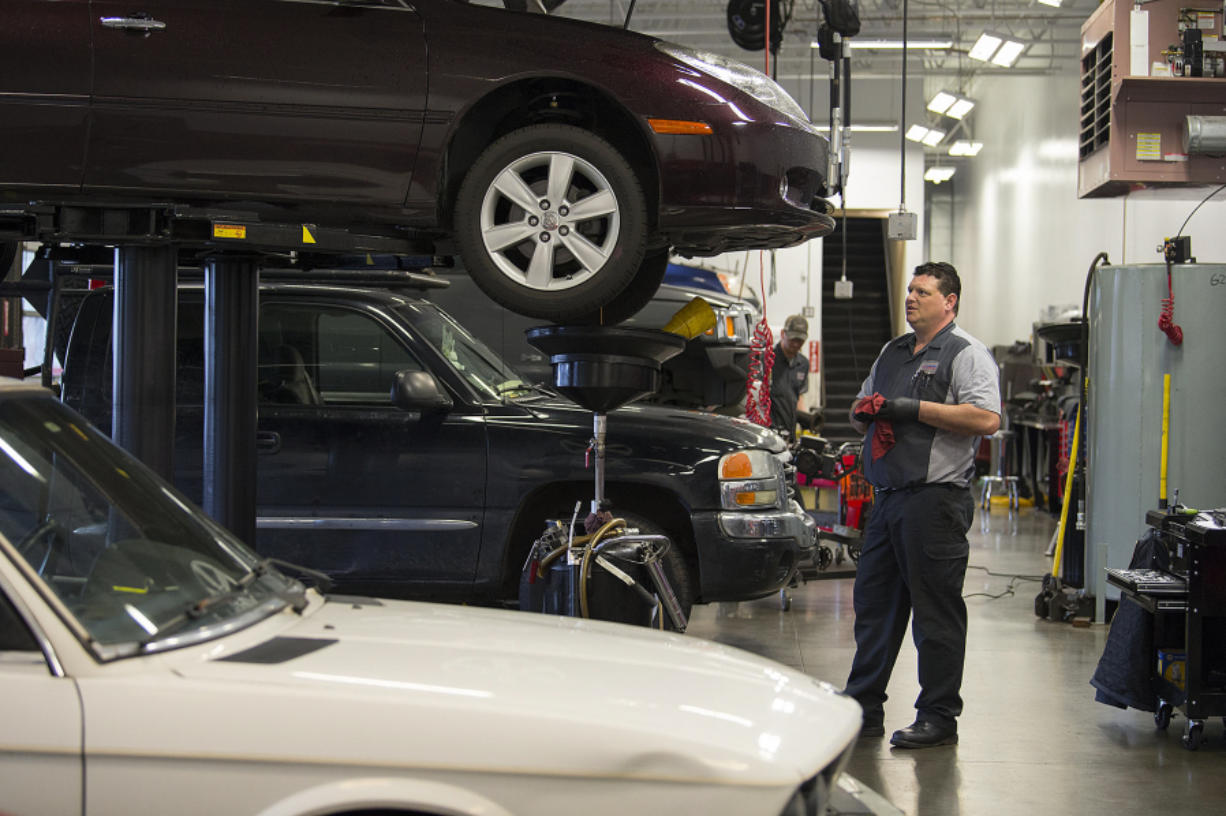 Automotive technician Dale Svendsen changes a car's oil at Gaynors Automotive in Salmon Creek. Gaynors is one of several automotive shops participating in Don't Drip and Drive, a regional campaign aimed at keeping vehicle fluids out of the environment.