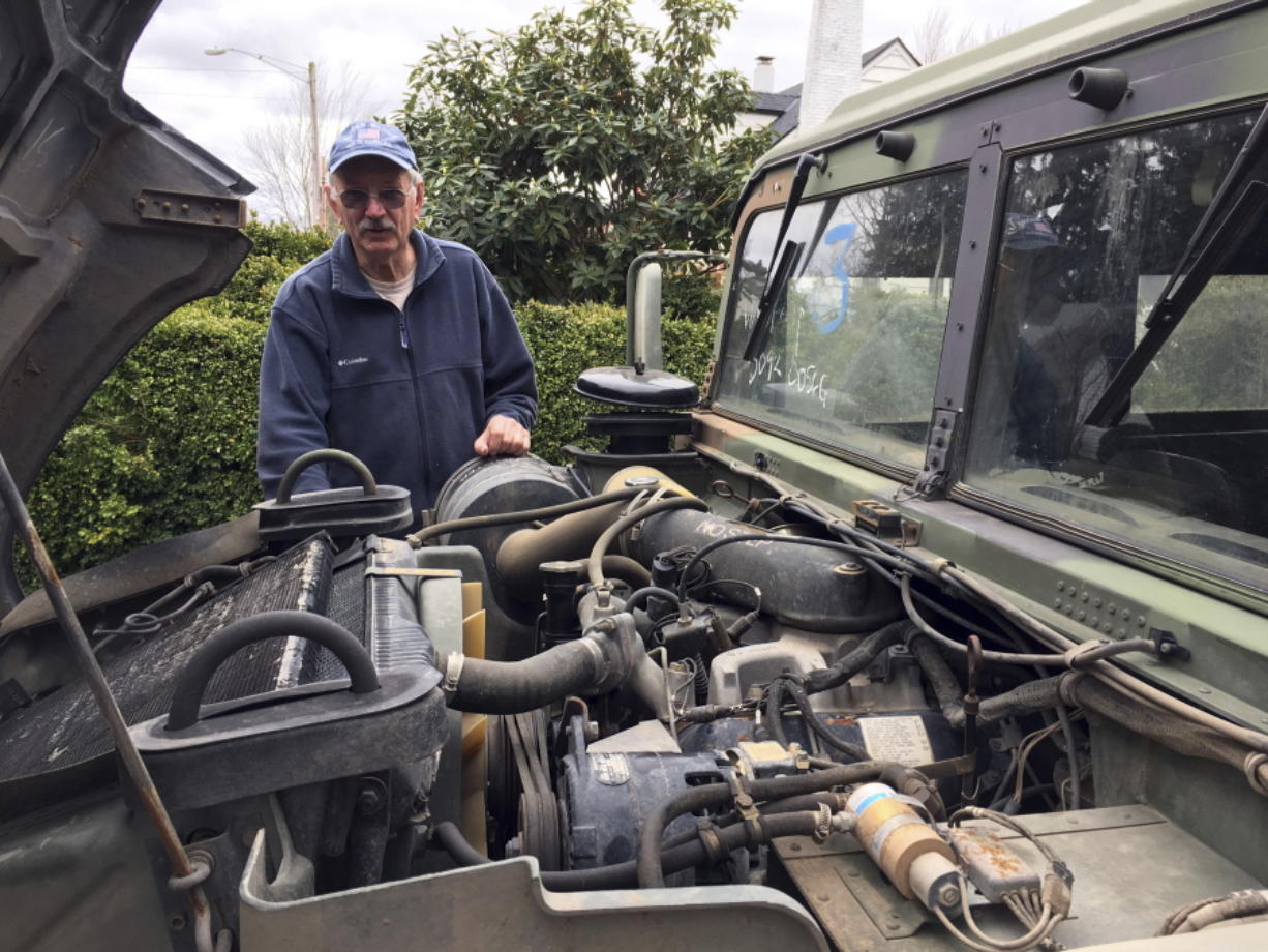 Hank Porter, 75, mayor of Stayton, Ore., stands with his 1990 military surplus Humvee outside his residence March 2. Oregon could be the first state to allow street use of retired military Humvees should state lawmakers approve a bill that was proposed at the request of Porter, who wants to tow war veterans through parades in Stayton during Fourth of July celebrations.