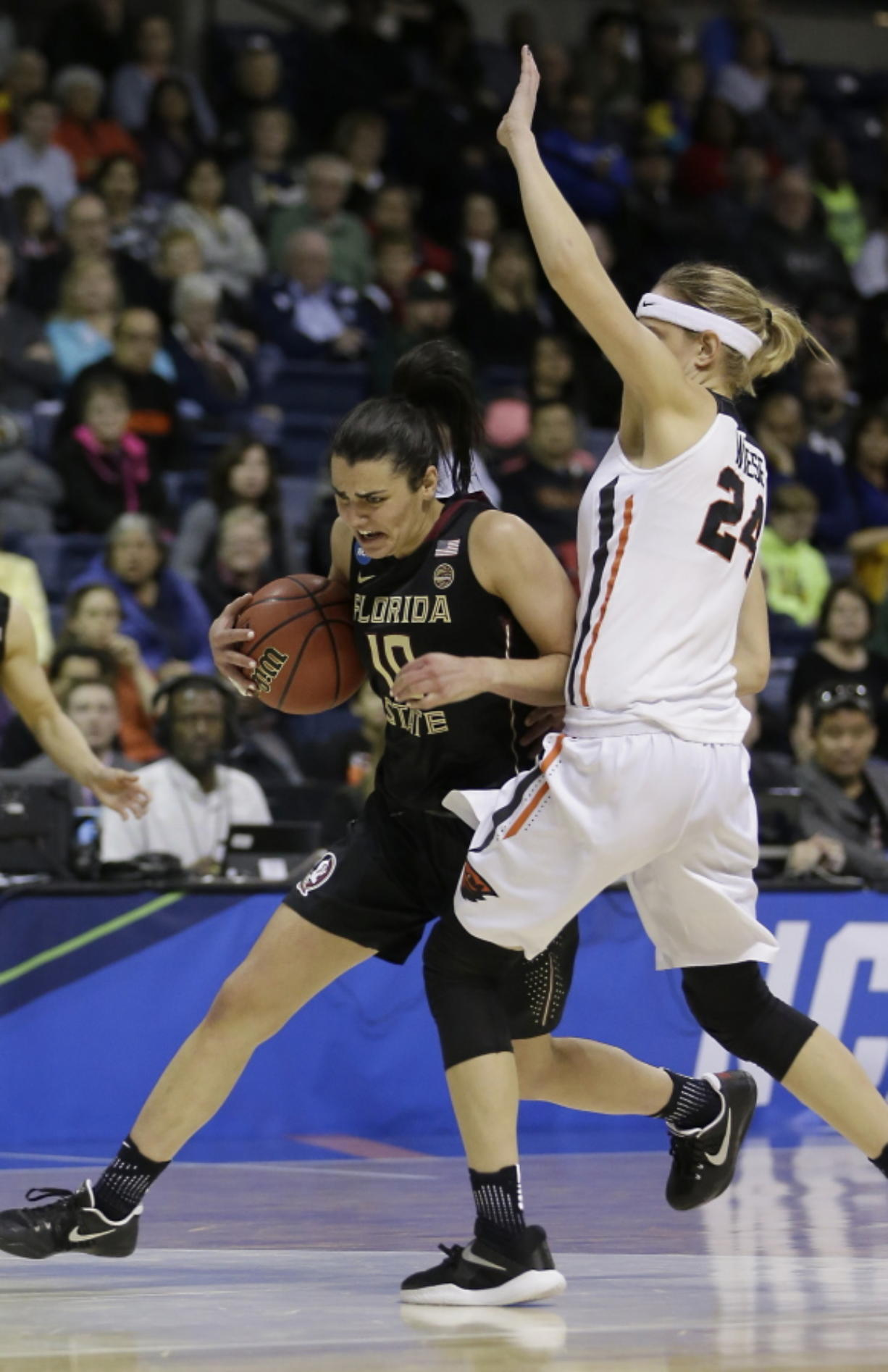 Florida State guard Leticia Romero, left, drives against Oregon State guard Sydney Wiese during the first half of a regional semi-final round game of an NCAA college basketball tournament, Saturday, March 25, 2017, in Stockton, Calif.
