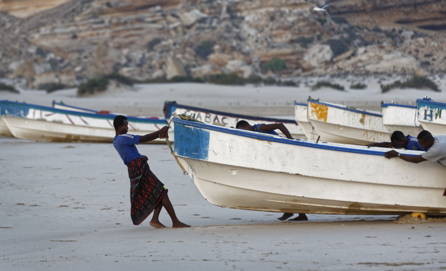 Fishermen Pull Their Boats Into The Indian Ocean Shortly After Dawn In The Former Pirate Village