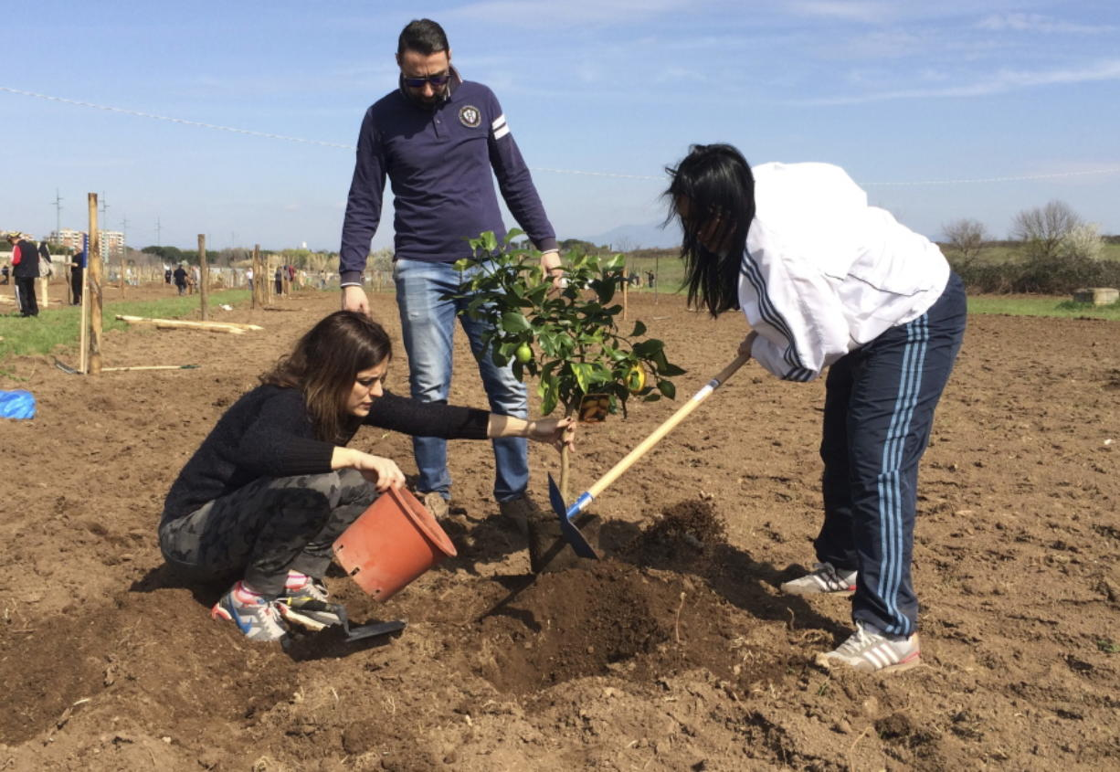 With pope's blessing, squatters farm land - Columbian com