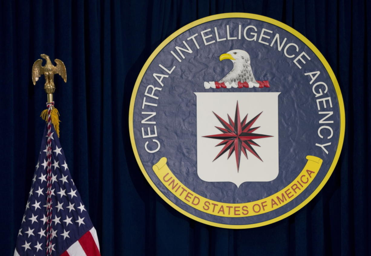 FILE - This April 13, 2016, file photo shows the seal of the Central Intelligence Agency at CIA headquarters in Langley, Va. An alleged CIA surveillance program disclosed by WikiLeaks on Tuesday, March 7, 2017, purportedly targeted security weaknesses in smart TVs, smartphones, personal computers and even cars, and enabled snooping that could circumvent encryption on communications apps such as Facebook???s WhatsApp. WikiLeaks is, for now, withholding details on the specific hacks used. But WikiLeaks claims that the data and documents it obtained reveal a broad program to bypass security measures on everyday products. (AP Photo/Carolyn Kaster, File)