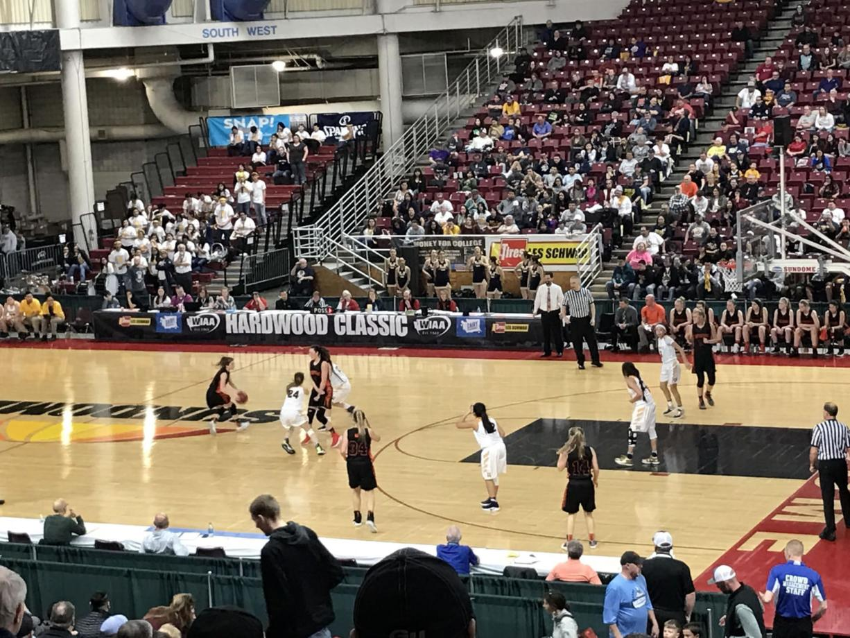 Mason Oberg (with ball) scored 13 points to lead the Washougal Panthers during Friday's 63-44 loss to Wapato in the 2A consolation semifinals.
