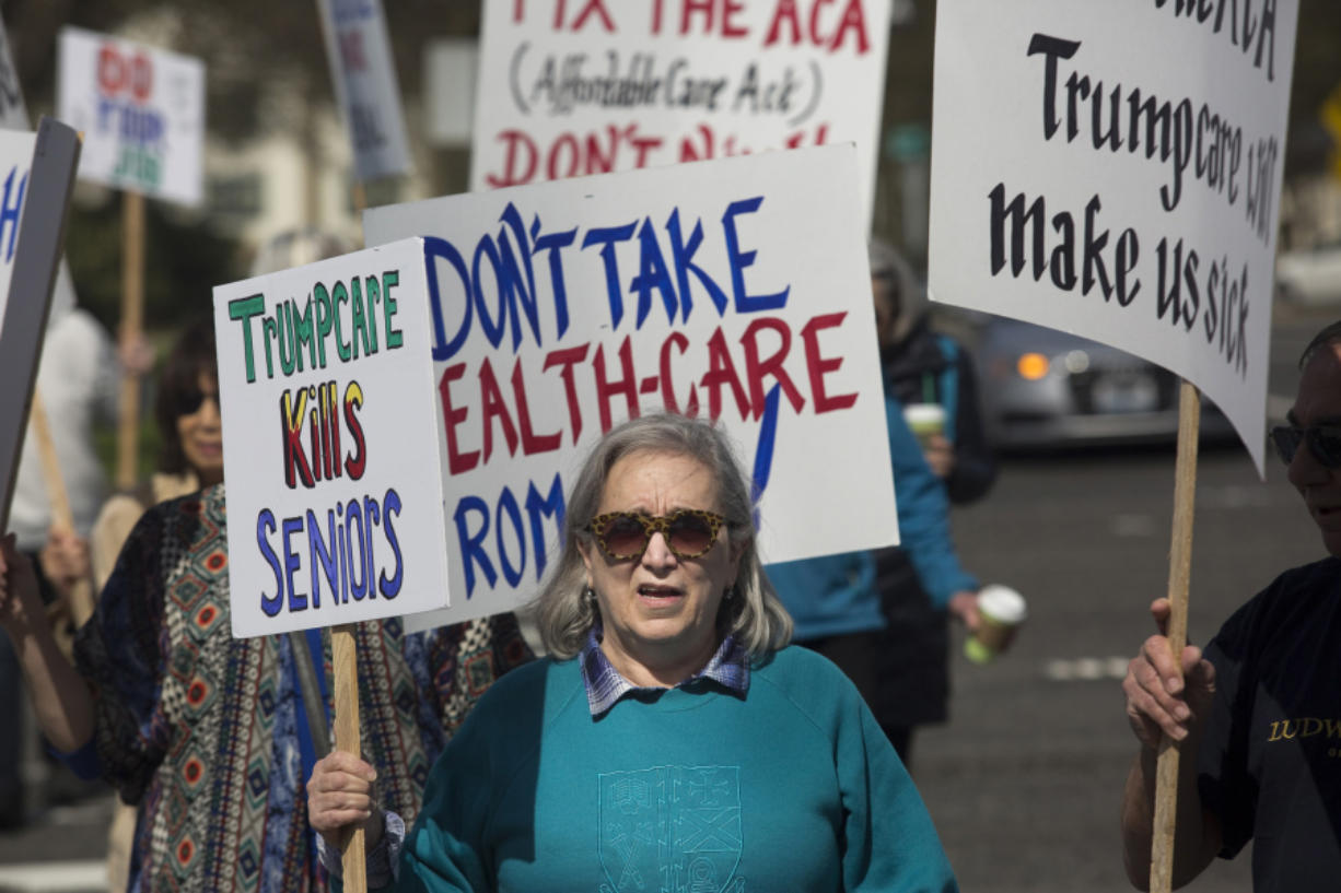 """Geri Baer waves a sign reading """"Trumpcare Kills Seniors"""" at a recent rally in Clark County. Several different Indivisible chapters coordinated their efforts and spread across Clark County, waving signs to show support for the Affordable Care Act."""