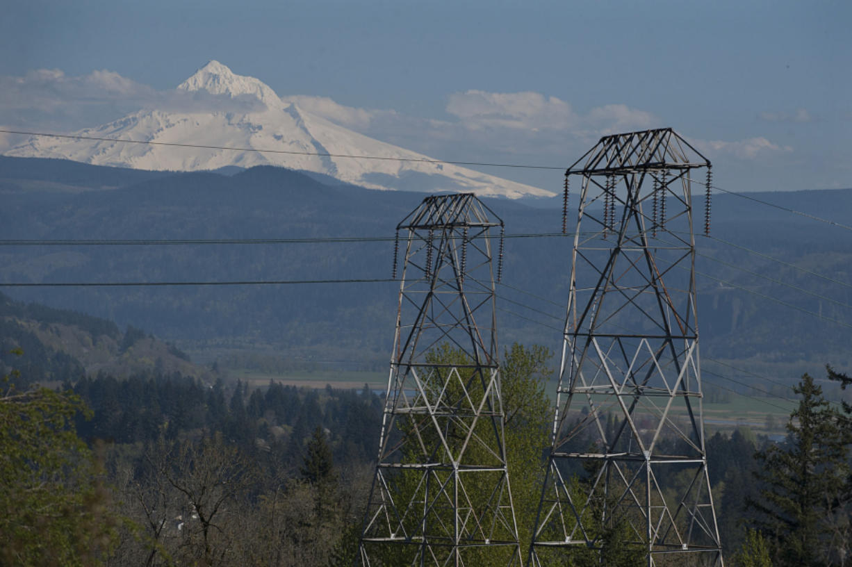 High voltage power lines are seen in 2016, looking east from Oak Creek Park as Mount Hood is visible in the background.
