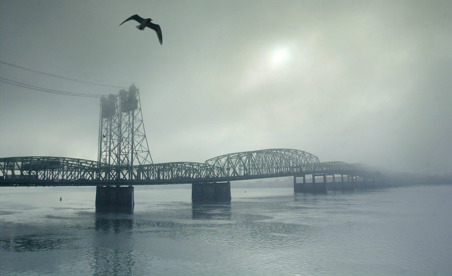 Fog obscures the Interstate 5 Bridge in December 2003. (Columbian files)