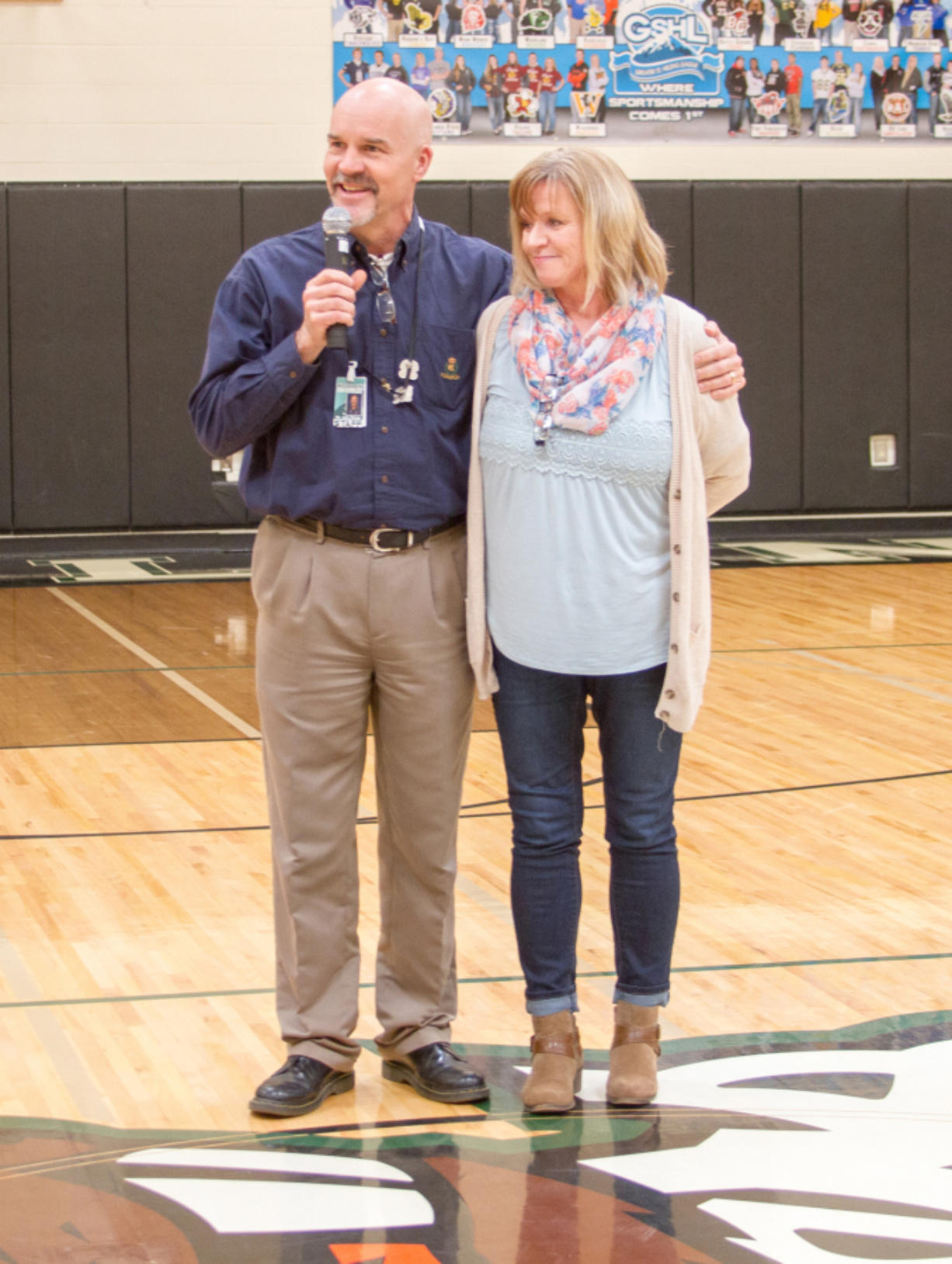 Woodland: Woodland High School Principal John Shoup congratulates Mary Ann Sturdivan, school counselor, for earning the 2017 Classified School Employee of the Year for the Educational Service District 112 region.