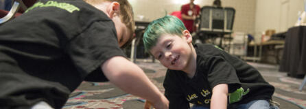 Declan Reagan, 5, right, plays with his twin brother, Adrian, during a bone marrow and blood donation event March 28 at The Nines hotel in Portland. Declan needs a lifesaving bone marrow transplant.