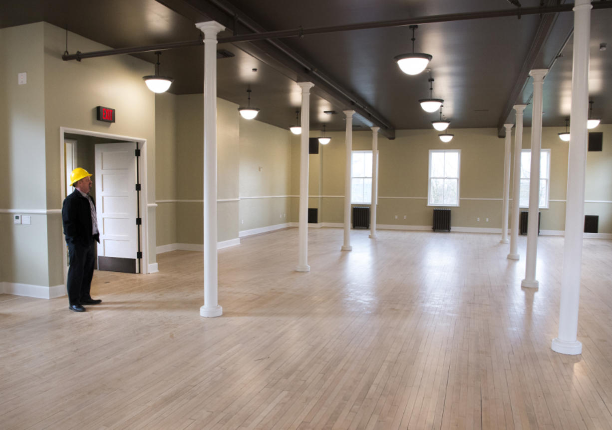 Kaare Hyde, the facilities manager at Fort Vancouver National Trust, looks around an empty room at the Artillery Barracks. The Trust and other government agencies have worked to make the historic U.S.