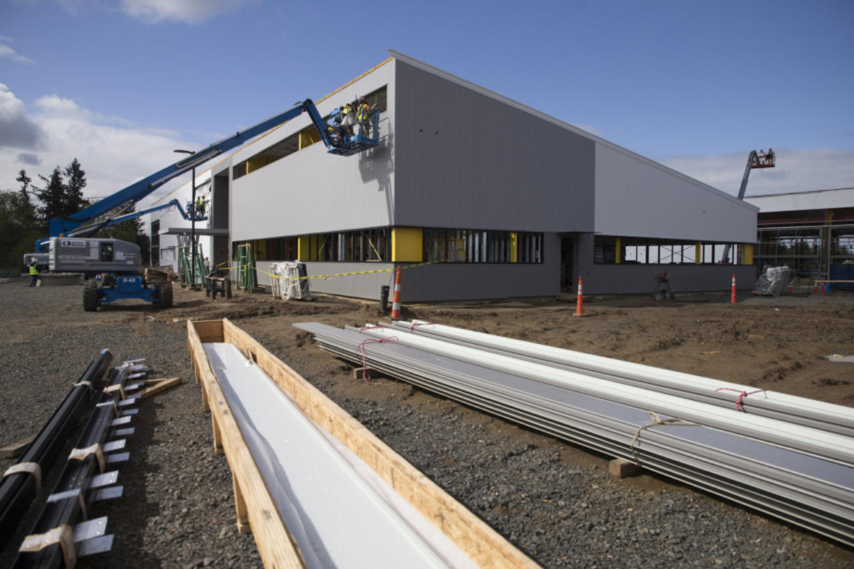 Construction continues Friday on the BPA's new regional maintenance facility at the company's Ross Complex in the Minnehaha neighborhood in Vancouver. The facility's new administration building, foreground, with the company's new maintenance building, at right in background.